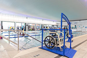adaptive wheelchair beside indoor pool
