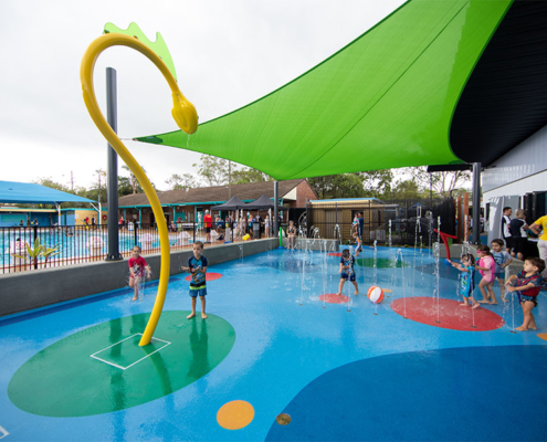 children pool and play area with children playing in the water
