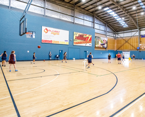 Indoor basketball court with players on it