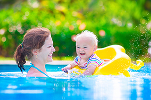 woman and child swimming in pool