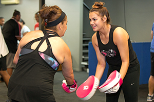 two women training with boxing gloves