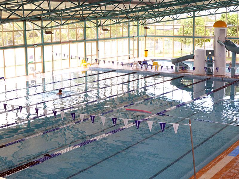 water slide beside indoor swimming pool