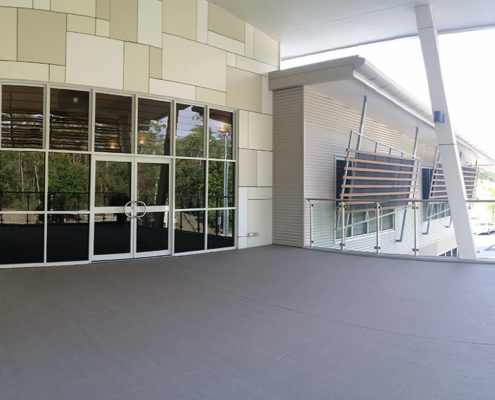 Large outside area with double doors leading into a building