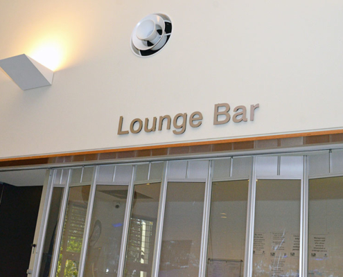 Lounge Bar sign above sliding doors