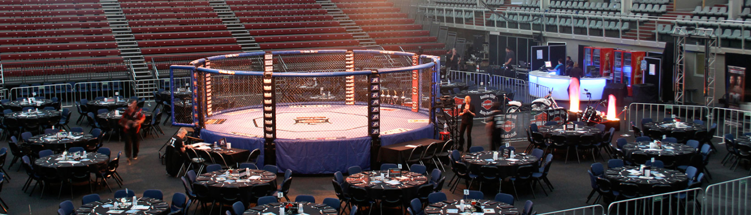 10 person tables set up around wrestling ring